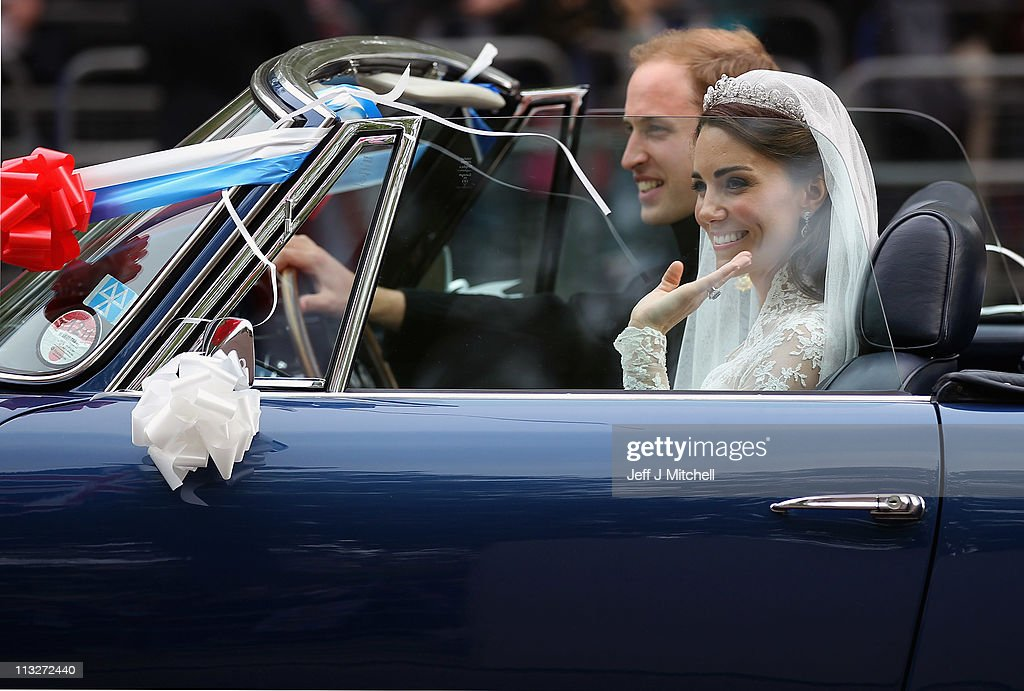 <a gi-track='captionPersonalityLinkClicked' href=/galleries/search?phrase=Prince+William&family=editorial&specificpeople=178205 ng-click='$event.stopPropagation()'>Prince William</a>, Duke of Cambridge and <a gi-track='captionPersonalityLinkClicked' href=/galleries/search?phrase=Catherine+-+Duchess+of+Cambridge&family=editorial&specificpeople=542588 ng-click='$event.stopPropagation()'>Catherine</a>, Duchess of Cambridge drive from Buckingham Palace to Clarence House in a decorated vintage Aston Martin sports car on April 29, 2011 in London, England. The marriage of the second in line to the British throne was led by the Archbishop of Canterbury and was attended by 1900 guests, including foreign Royal family members and heads of state. Thousands of well-wishers from around the world have also flocked to London to witness the spectacle and pageantry of the Royal Wedding