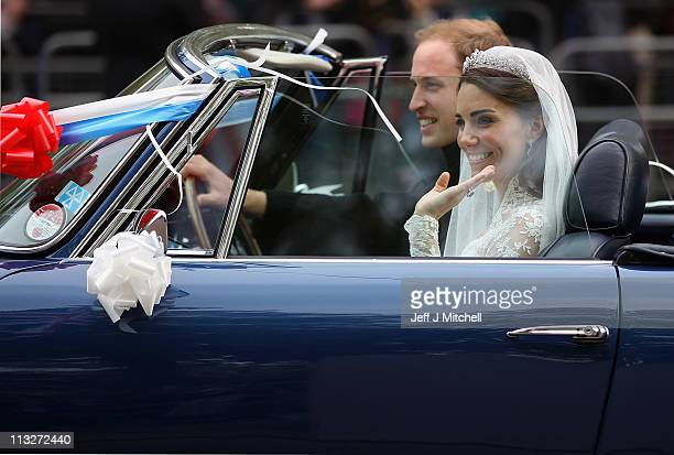 Prince William Duke of Cambridge and Catherine Duchess of Cambridge drive from Buckingham Palace to Clarence House in a decorated vintage Aston...