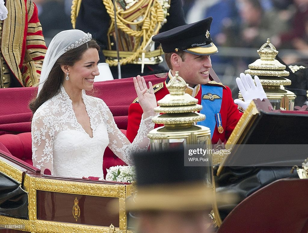 <a gi-track='captionPersonalityLinkClicked' href=/galleries/search?phrase=Prince+William&family=editorial&specificpeople=178205 ng-click='$event.stopPropagation()'>Prince William</a>, Duke of Cambridge and Catherine, Duchess of Cambridge make the journey by carriage procession to Buckingham Palace past crowds of spectators following their marriage at Westminster Abbey on April 29, 2011 in London, England. The marriage of the second in line to the British throne was led by the Archbishop of Canterbury and was attended by 1900 guests, including foreign Royal family members and heads of state. Thousands of well-wishers from around the world have also flocked to London to witness the spectacle and pageantry of the Royal Wedding.