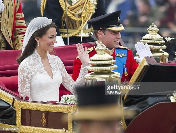 Prince William Duke of Cambridge and Catherine Duchess of Cambridge make the journey by carriage procession to Buckingham Palace past crowds of...