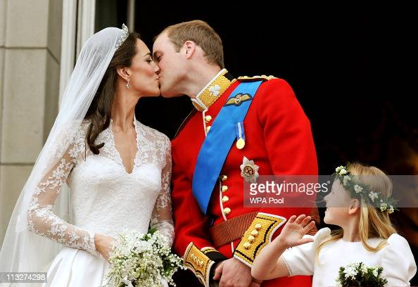 Prince William Duke of Cambridge and Catherine Duchess of Cambridge kiss on the balcony of Buckingham Palace after getting married on April 29 2011...