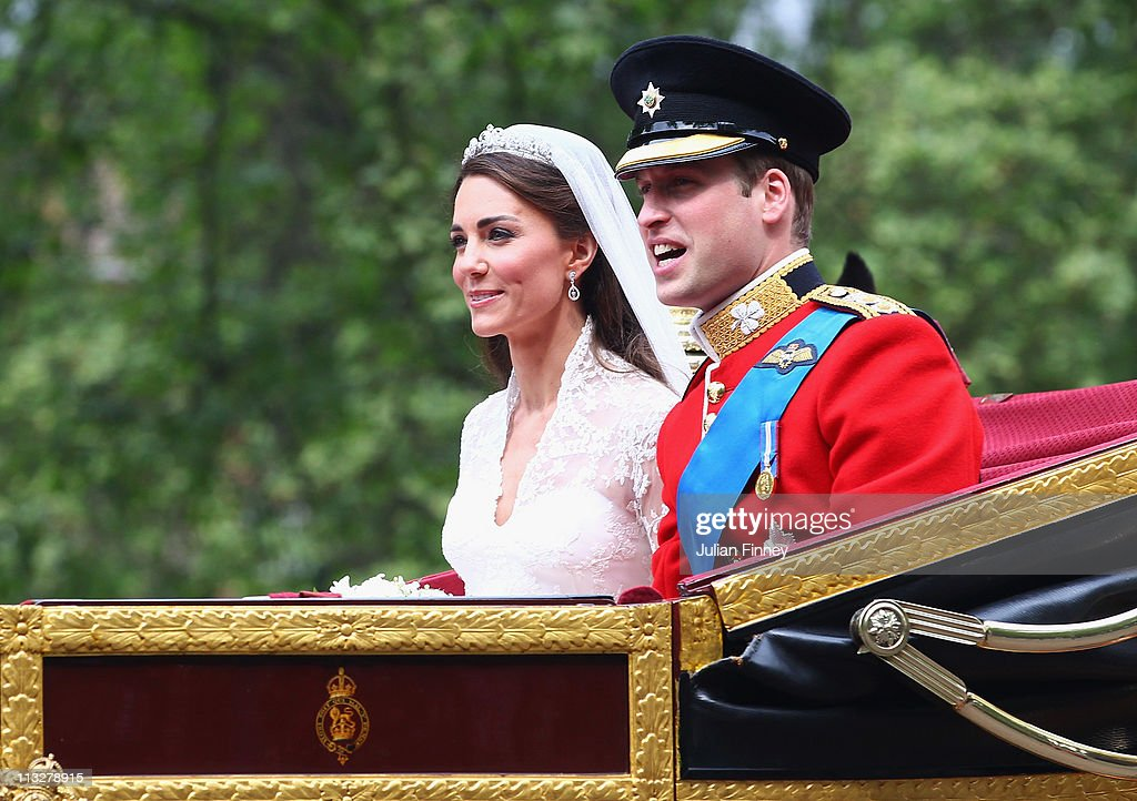 Prince William Duke of Cambridge and Catherine Duchess of Cambridge make the journey by carriage procession to Buckingham Palace following their...