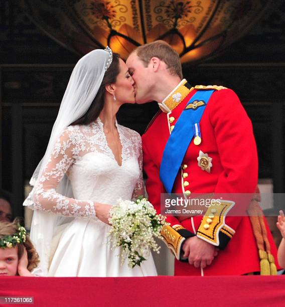 Prince William Duke of Cambridge and Catherine Duchess of Cambridge kiss on the balcony of Buckingham Palace on April 29 2011 in London England