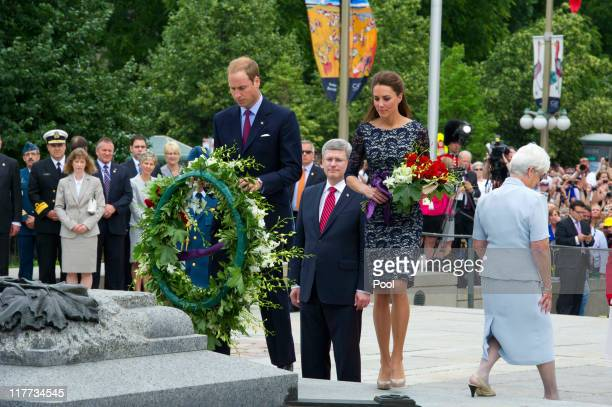 Prince William Duke of Cambridge and Catherine Duchess of Cambridge lays a wreath at the tomb of the Unknown Soldier as they visit the National War...
