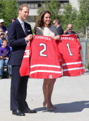 Prince William Duke of Cambridge and Catherine Duchess of Cambridge pose with Hockey shirts they were presented with during an official welcome...