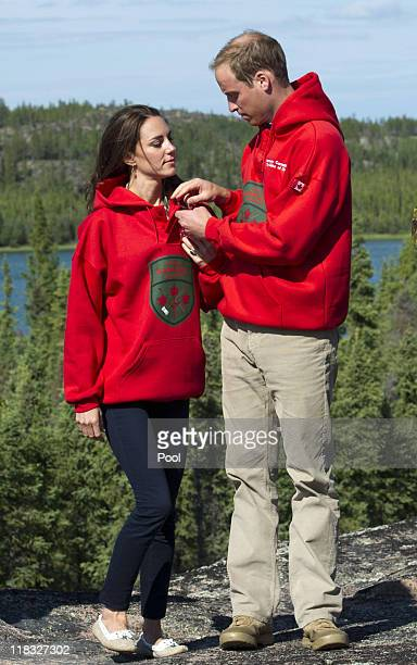 Prince William Duke of Cambridge and Catherine Duchess of Cambridge wear the sweaters of the Canadian Rangers after being made honourary members on...