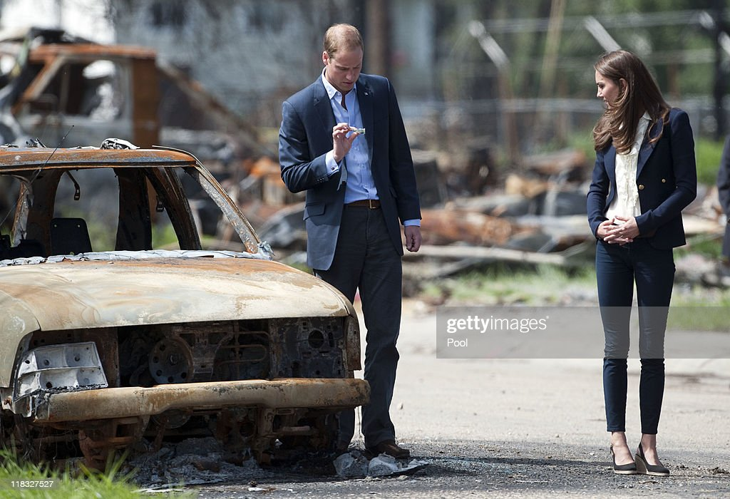<a gi-track='captionPersonalityLinkClicked' href=/galleries/search?phrase=Prince+William&family=editorial&specificpeople=178205 ng-click='$event.stopPropagation()'>Prince William</a>, Duke of Cambridge and <a gi-track='captionPersonalityLinkClicked' href=/galleries/search?phrase=Catherine+-+Duchess+of+Cambridge&family=editorial&specificpeople=542588 ng-click='$event.stopPropagation()'>Catherine</a>, Duchess of Cambridge inspect a fire-damaged car in a part of town devastated by a fire in May 2011, on July 7, 2011 in Slave Lake, Alberta. The newly married Royal Couple are on the seventh day of their first joint overseas tour. The 12 day visit to North America is taking in some of the more remote areas of the country such as Prince Edward Island, Yellowknife and Calgary. The Royal couple started off their tour by joining millions of Canadians in taking part in Canada Day celebrations which mark Canada's 144th Birthday.