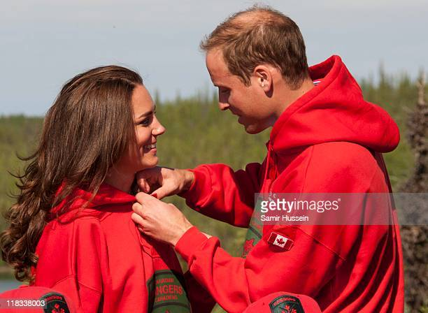 Prince William Duke of Cambridge and Catherine Duchess of Cambridge try on red jackets as they visit the Canadian Rangers station on July 5 2011 in...