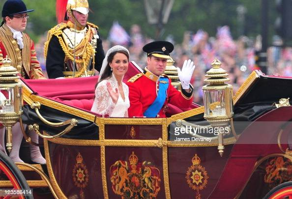 Prince William Duke of Cambridge and Catherine Duchess of Cambridge greet crowd of admirers while arriving to Buckingham Palace on April 29 2011 in...