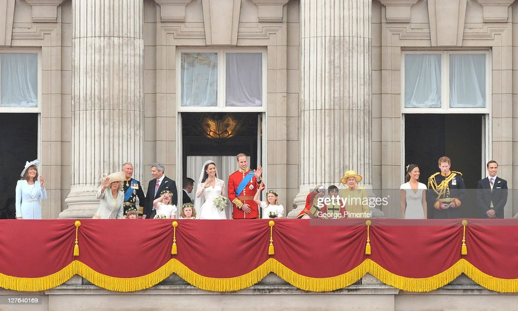 Prince William, Duke of Cambridge and Catherine, Duchess of Cambridge greet well-wishers next to members of their family on the balcony at Buckingham Palace on April 29, 2011 in London, England.