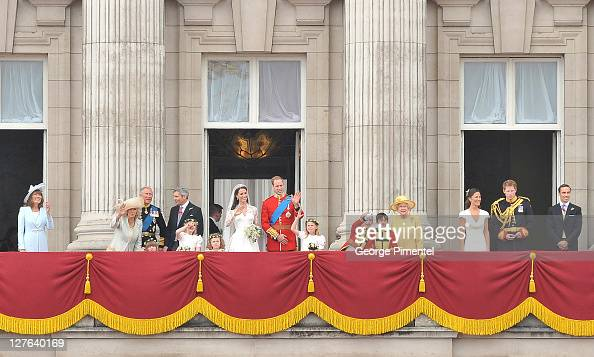 Prince William Duke of Cambridge and Catherine Duchess of Cambridge greet wellwishers next to members of their family on the balcony at Buckingham...