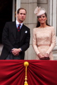 Prince William Duke of Cambridge and Catherine Duchess of Cambridge wave to the crowds from Buckingham Palace during the Diamond Jubilee carriage...