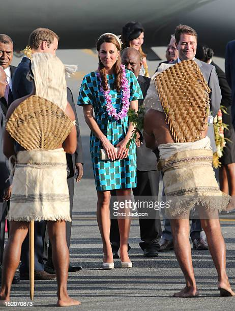 Prince William Duke of Cambridge and Catherine Duchess of Cambridge twatch traditional dancing as they arrive at Honiara International Airport during...