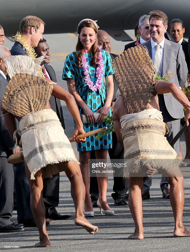 Prince William, Duke of Cambridge and Catherine, Duchess of Cambridge twatch traditional dancing as they arrive at Honiara International Airport during their Diamond Jubilee tour of the Far East on September 16, 2012 in Honiara, Guadalcanal Island. Prince William, Duke of Cambridge and Catherine, Duchess of Cambridge are on a Diamond Jubilee tour representing the Queen taking in Singapore, Malaysia, the Solomon Islands and Tuvalu.