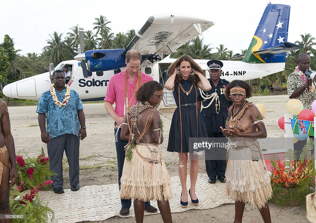 Prince William, Duke of Cambridge and Catherine, Duchess of Cambridge are seen after being presented with garlands as they arrive in Honiara on their way to Tivanipupu on day 7 of their Diamond Jubilee Tour, on September 17, 2012 in Marau, Guadacanal Province, Solomon Islands. Prince William, Duke of Cambridge and Catherine, Duchess of Cambridge arrived in the Solomon Islands as the first stop of the Pacific leg of their nine day Diamond Jubilee Tour of the Far East and South Pacific.