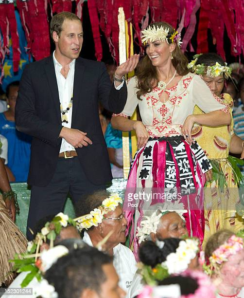 Prince William Duke of Cambridge and Catherine Duchess of Cambridge dance with the ladies at the Vaiku Falekaupule for an entertainment programme on...