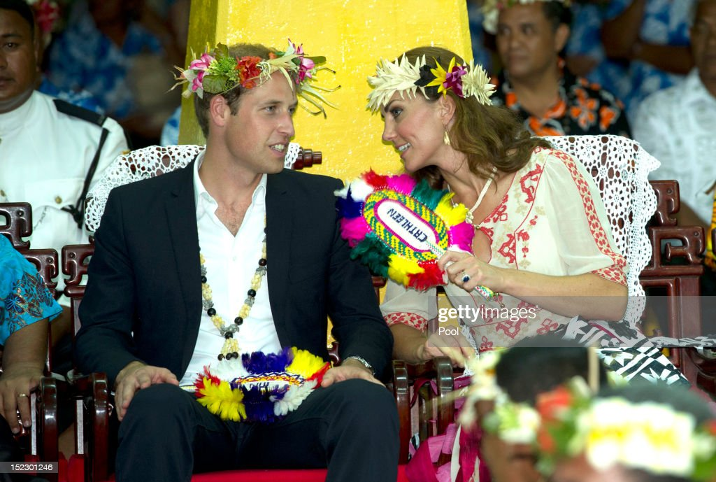 Prince William, Duke of Cambridge and Catherine, Duchess of Cambridge watch the dancing ladies at the Vaiku Falekaupule for an entertainment programme on September 18, 2012 in Tuvalu. Prince William, Duke of Cambridge and Catherine, Duchess of Cambridge are on a Diamond Jubilee tour representing the Queen taking in Singapore, Malaysia, the Solomon Islands and Tuvalu.