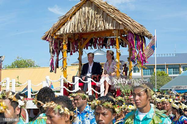 Prince William Duke of Cambridge and Catherine Duchess of Cambridge are carried as they bid farewell on September 19 2012 in Tuvalu Prince William...