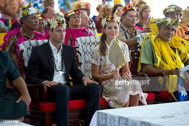 Prince William Duke of Cambridge and Catherine Duchess of Cambridge are given gifts as they bid farewell on September 19 2012 in Tuvalu Prince...