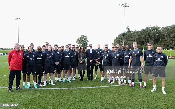 Prince William Duke of Cambridge and Catherine Duchess of Cambridge pose with the England team during the official launch of The Football...