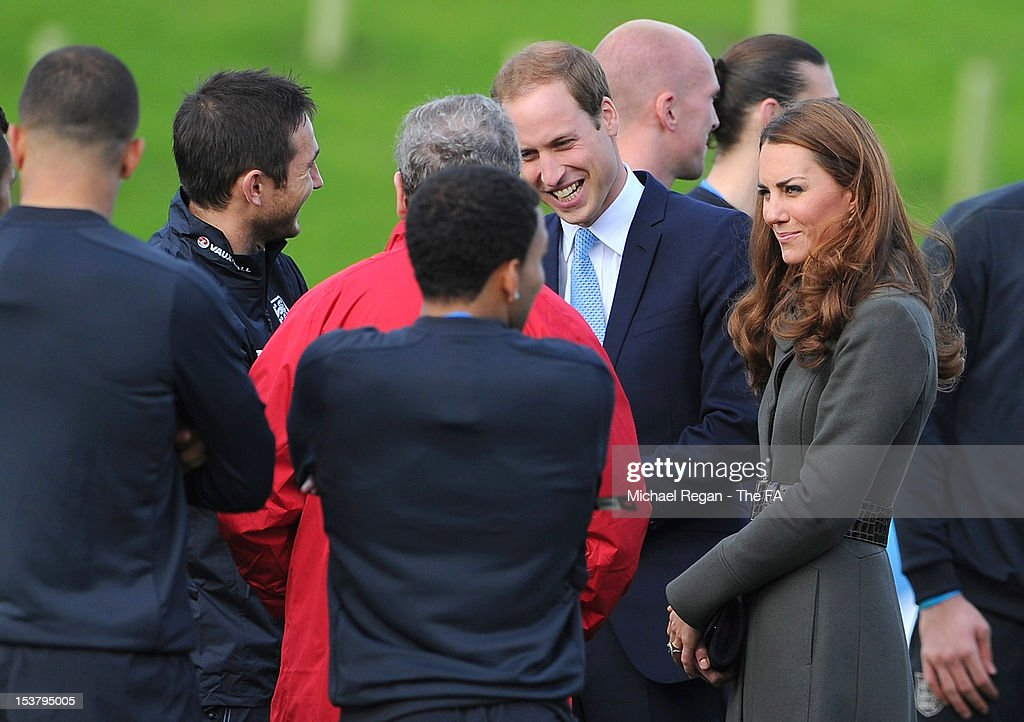 Prince William, Duke of Cambridge and <a gi-track='captionPersonalityLinkClicked' href=/galleries/search?phrase=Catherine+-+Herzogin+von+Cambridge&family=editorial&specificpeople=542588 ng-click='$event.stopPropagation()'>Catherine</a>, Duchess of Cambridge speak with the England team during the official launch of The Football Association's National Football Centre at St George's Park on October 9, 2012 in Burton-upon-Trent, England.