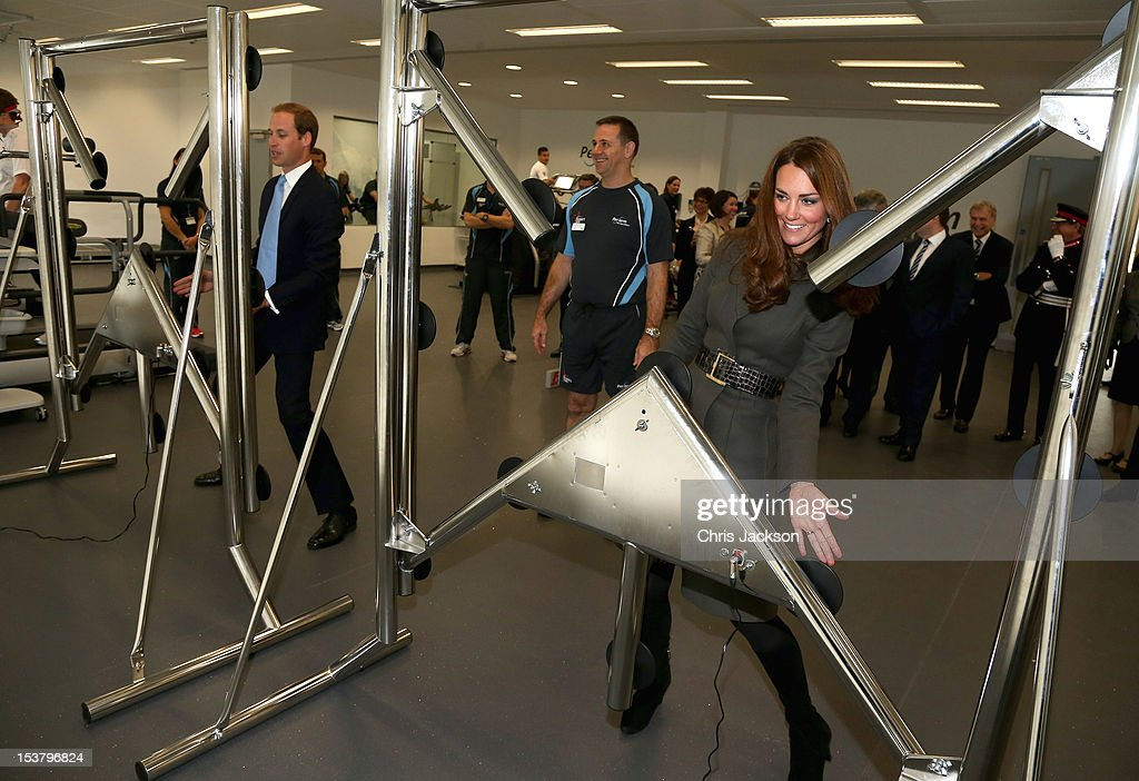 <a gi-track='captionPersonalityLinkClicked' href=/galleries/search?phrase=Prince+William&family=editorial&specificpeople=178205 ng-click='$event.stopPropagation()'>Prince William</a>, Duke of Cambridge and Catherine, Duchess of Cambridge play a reaction game in the new gym during the official launch of The Football Association's National Football Centre at St George's Park on October 9, 2012 in Burton-upon-Trent, England.