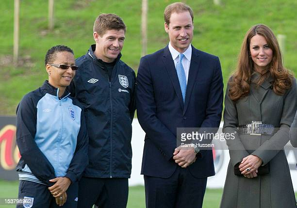 Prince William Duke of Cambridge and Catherine Duchess of Cambridge pose with England Women's manager Hope Powell and Steven Gerrard during the...