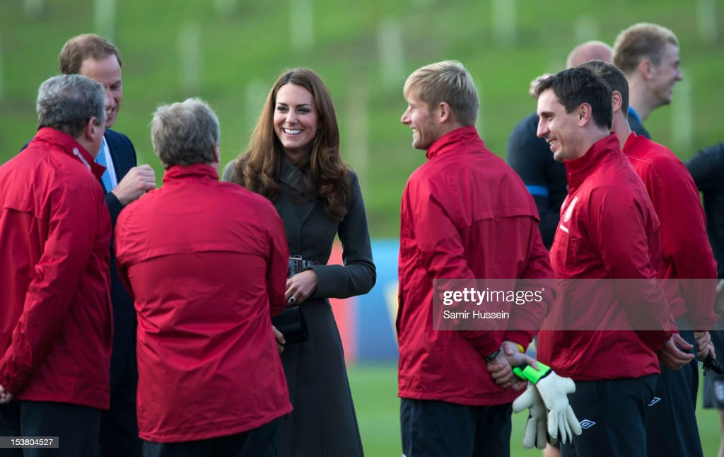 <a gi-track='captionPersonalityLinkClicked' href=/galleries/search?phrase=Prince+William&family=editorial&specificpeople=178205 ng-click='$event.stopPropagation()'>Prince William</a>, Duke of Cambridge and <a gi-track='captionPersonalityLinkClicked' href=/galleries/search?phrase=Catherine+-+Duchess+of+Cambridge&family=editorial&specificpeople=542588 ng-click='$event.stopPropagation()'>Catherine</a>, Duchess of Cambridge meet members of the England football team during the official launch of The Football Association's National Football Centre at St George's Park on October 9, 2012 in Burton-upon-Trent, England.