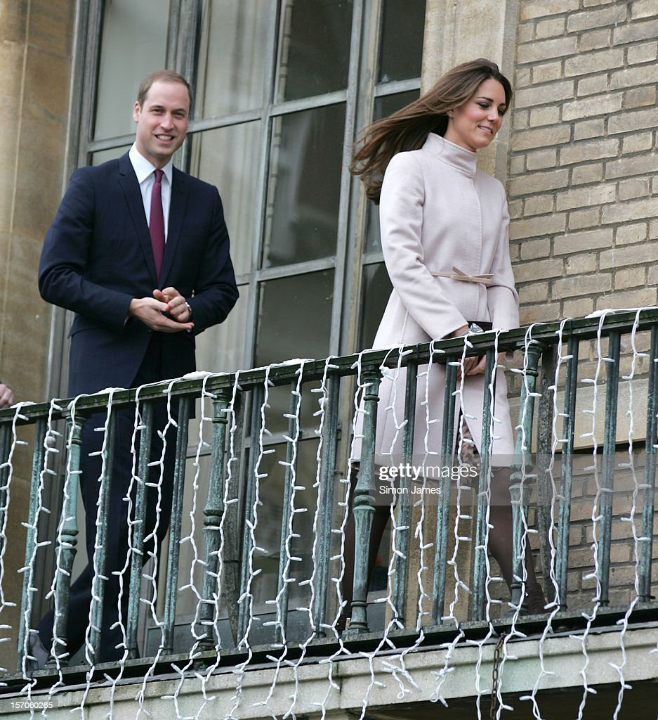 Prince William, Duke of Cambridge and Catherine, Duchess of Cambridge on the balcony of Cambridge Guildhall as they pay an official visit to Cambridge on November 28, 2012 in Cambridge, England.
