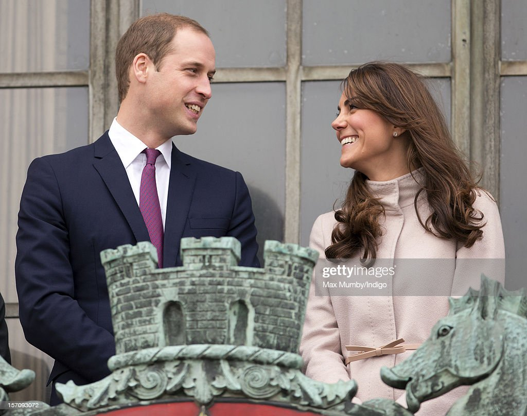 Prince William, Duke of Cambridge and Catherine, Duchess of Cambridge stand on the balcony of The Guildhall during their first official visit to Cambridge on November 28, 2012 in Cambridge, England.