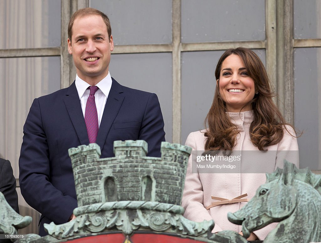 <a gi-track='captionPersonalityLinkClicked' href=/galleries/search?phrase=Prince+William&family=editorial&specificpeople=178205 ng-click='$event.stopPropagation()'>Prince William</a>, Duke of Cambridge and Catherine, Duchess of Cambridge stand on the balcony of The Guildhall during their first official visit to Cambridge on November 28, 2012 in Cambridge, England.