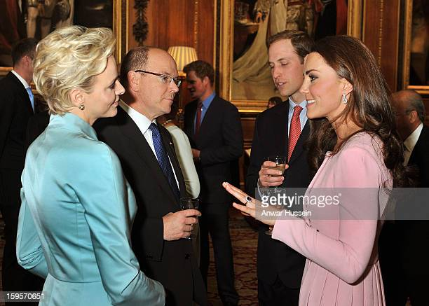 Prince William Duke of Cambridge and Catherine Duchess of Cambridge chat to Prince Albert ll of Monaco and Princess Charlene during a pre luncheon...