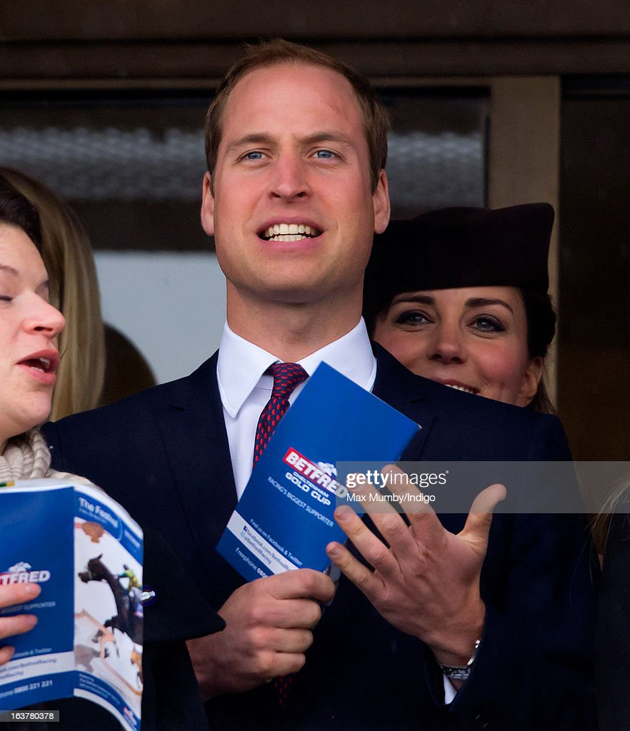 Prince William, Duke of Cambridge and Catherine, Duchess of Cambridge watch the racing as they attend Day 4 of The Cheltenham Festival at Cheltenham Racecourse on March 15, 2013 in London, England.
