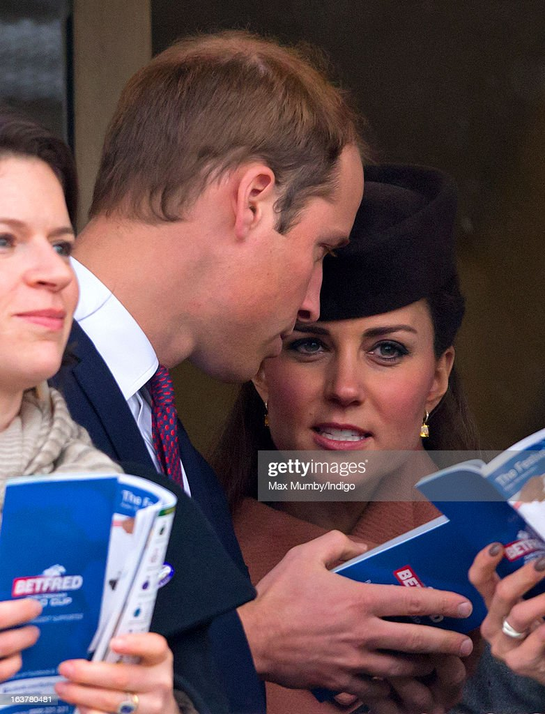 Prince William, Duke of Cambridge and <a gi-track='captionPersonalityLinkClicked' href=/galleries/search?phrase=Catherine+-+Duchesse+de+Cambridge&family=editorial&specificpeople=542588 ng-click='$event.stopPropagation()'>Catherine</a>, Duchess of Cambridge watch the racing as they attend Day 4 of The Cheltenham Festival at Cheltenham Racecourse on March 15, 2013 in London, England.