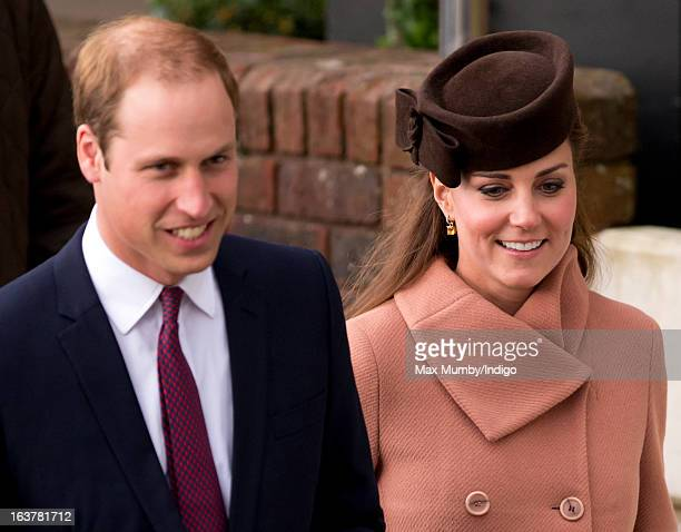 Prince William Duke of Cambridge and Catherine Duchess of Cambridge watch the racing as they attend Day 4 of The Cheltenham Festival at Cheltenham...