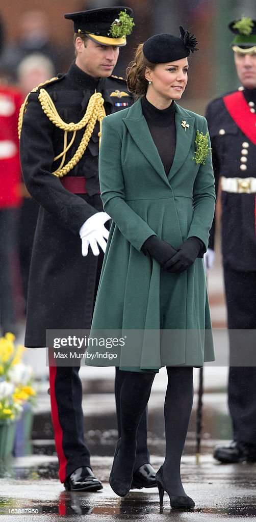 Prince William, Duke of Cambridge (in his role as Colonel of the Regiment) and Catherine, Duchess of Cambridge attend the St Patrick's Day Parade at Mons Barracks on March 17, 2013 in Aldershot, England.