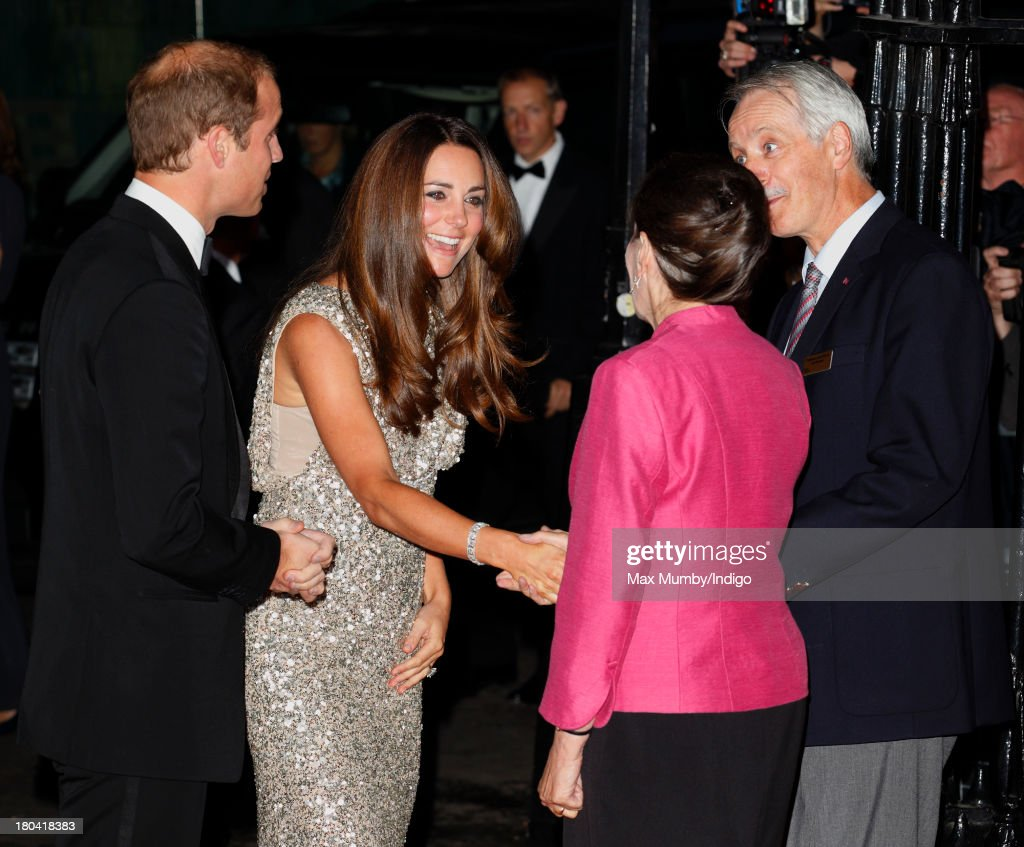 Prince William, Duke of Cambridge and Catherine, Duchess of Cambridge greet Professor Dame Jean Thomas (Vice President of The Royal Society) and Professor John Pethica (Vice President of The Royal Society) as they arrive to attend the Tusk Conservation Awards at The Royal Society on September 12, 2013 in London, England.