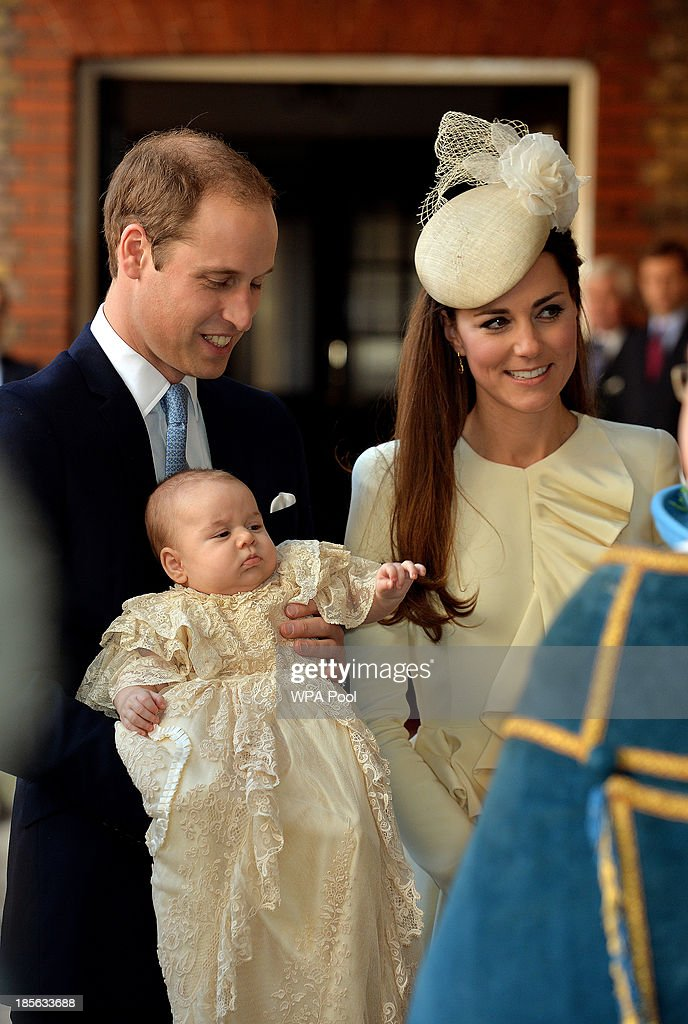 Prince William, Duke of Cambridge and Catherine, Duchess of Cambridge arrive, holding their son Prince George, at Chapel Royal in St James's Palace, ahead of the christening of the three month-old Prince George of Cambridge by the Archbishop of Canterbury on October 23, 2013 in London, England.