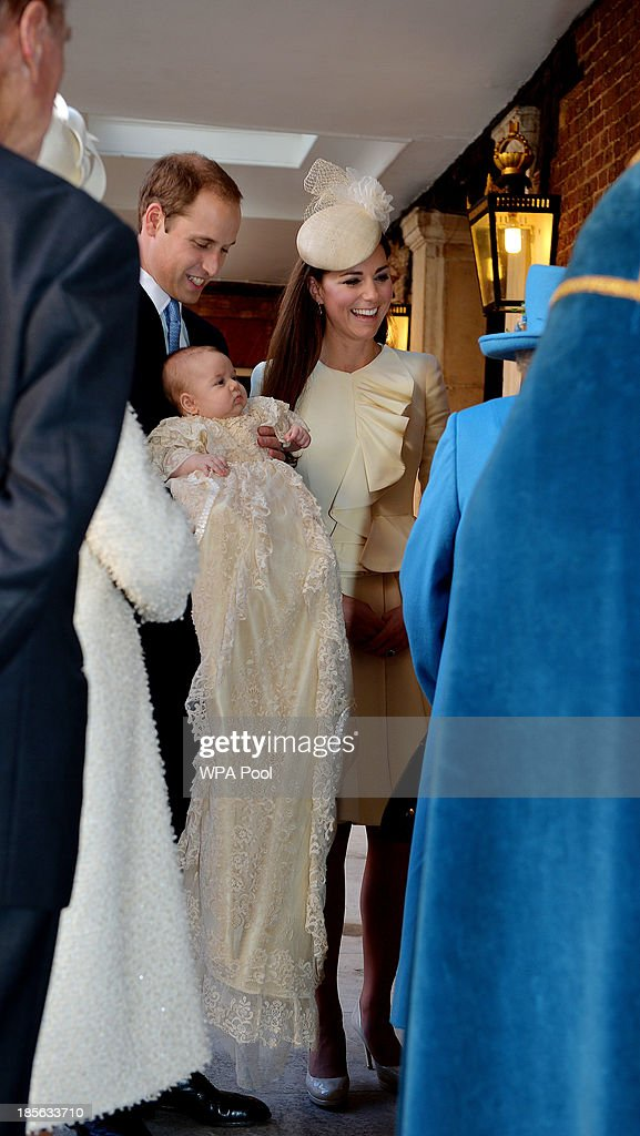 Prince William, Duke of Cambridge and Catherine, Duchess of Cambridge talk to Queen Elizabeth II (R) as they arrive, holding their son Prince George, at Chapel Royal in St James's Palace, ahead of the christening of the three month-old Prince George of Cambridge by the Archbishop of Canterbury on October 23, 2013 in London, England.