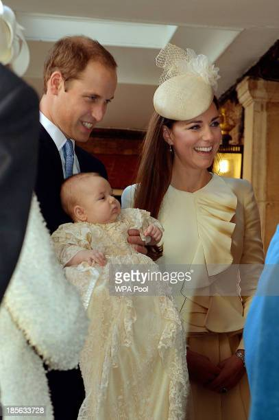 Prince William Duke of Cambridge and Catherine Duchess of Cambridge talk to Queen Elizabeth II as they arrive holding their son Prince George at...