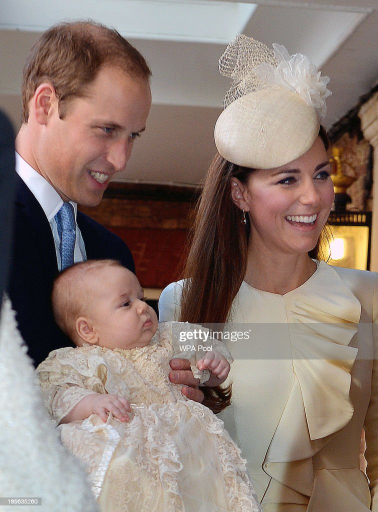 <a gi-track='captionPersonalityLinkClicked' href=/galleries/search?phrase=Prince+William&family=editorial&specificpeople=178205 ng-click='$event.stopPropagation()'>Prince William</a>, Duke of Cambridge and Catherine, Duchess of Cambridge talk to Queen <a gi-track='captionPersonalityLinkClicked' href=/galleries/search?phrase=Elizabeth+II&family=editorial&specificpeople=67226 ng-click='$event.stopPropagation()'>Elizabeth II</a> (not pictured) as they arrive, holding their son Prince George, at Chapel Royal in St James's Palace, ahead of the christening of the three month-old <a gi-track='captionPersonalityLinkClicked' href=/galleries/search?phrase=Prince+George+of+Cambridge&family=editorial&specificpeople=11176510 ng-click='$event.stopPropagation()'>Prince George of Cambridge</a> by the Archbishop of Canterbury on October 23, 2013 in London, England.