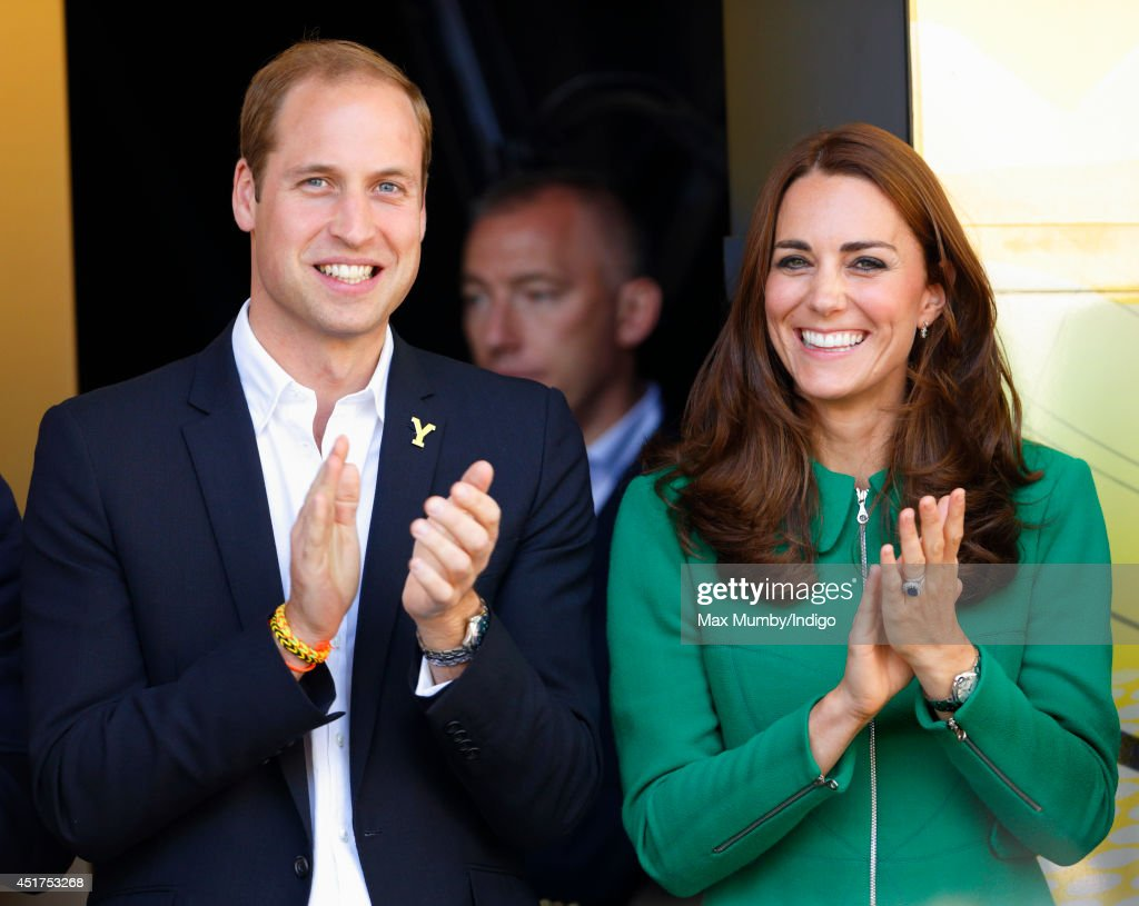 Prince William, Duke of Cambridge and <a gi-track='captionPersonalityLinkClicked' href=/galleries/search?phrase=Catherine+-+Hertiginna+av+Cambridge&family=editorial&specificpeople=542588 ng-click='$event.stopPropagation()'>Catherine</a>, Duchess of Cambridge stand on the podium at the finish of stage one of the Tour de France on July 5, 2014 in Harrogate, England.