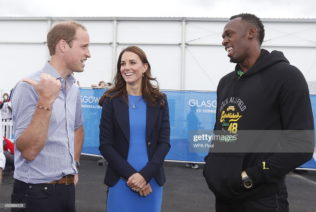 Prince William, Duke of Cambridge and Catherine, Duchess of Cambridge meet Usain Bolt during a visit to the Commonwealth Games Village on July 29, 2014 in Glasgow, Scotland.