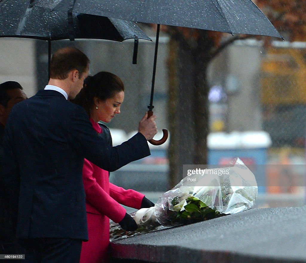 Prince William Duke of Cambridge and Catherine Duchess of Cambridge lay flowers in memory of the victims of the September 11 terrorist attacks during...