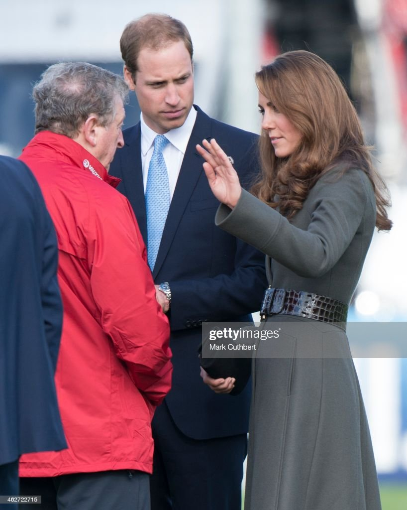 Prince William, Duke of Cambridge and Catherine, Duchess of Cambridge talk with England manager Roy Hodgson as they attend the official launch of The Football Association's National Football Centre at St George's Park on October 9, 2012 in Burton, England.