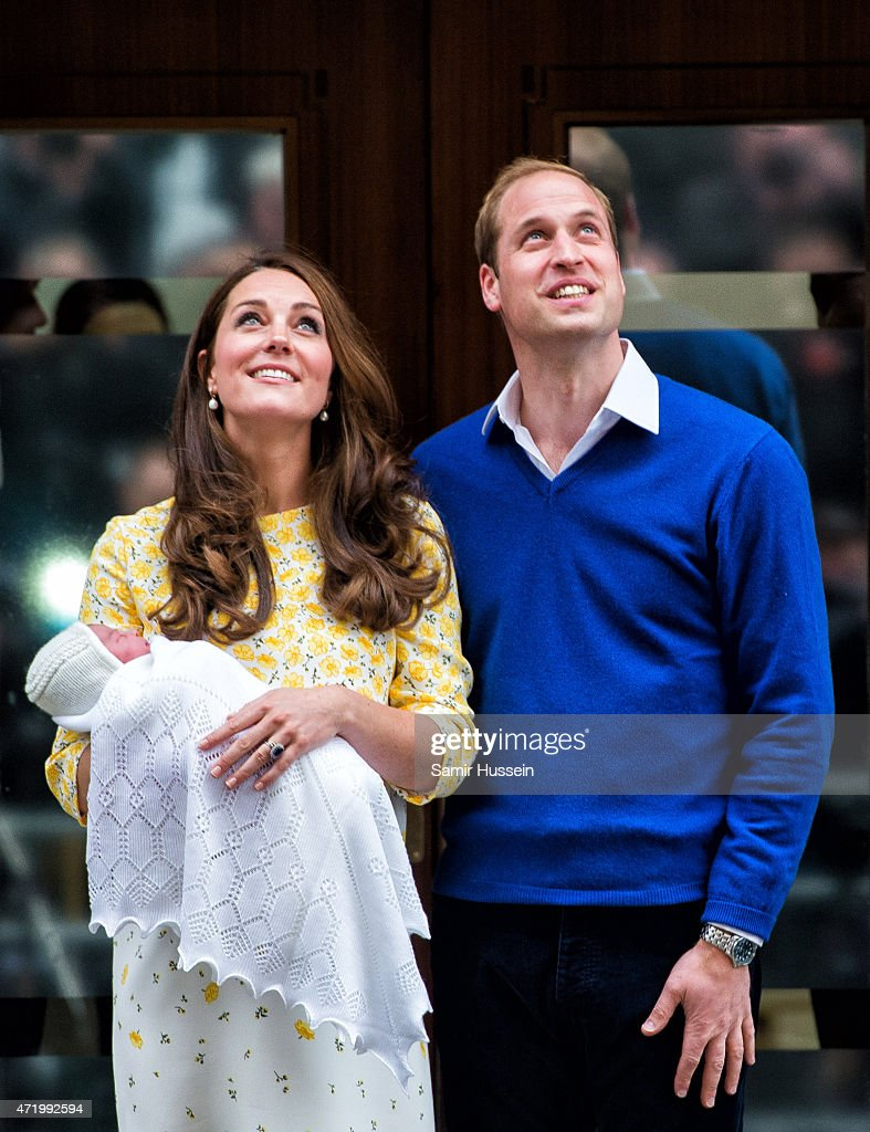 Prince William, Duke of Cambridge and Catherine, Duchess of Cambridge depart the Lindo Wing with their newborn baby daughter at St Mary's Hospital on May 2, 2015 in London, England.
