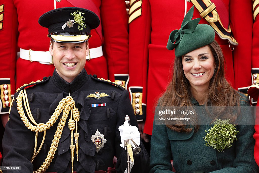 <a gi-track='captionPersonalityLinkClicked' href=/galleries/search?phrase=Prince+William&family=editorial&specificpeople=178205 ng-click='$event.stopPropagation()'>Prince William</a>, Duke of Cambridge and <a gi-track='captionPersonalityLinkClicked' href=/galleries/search?phrase=Catherine+-+Duchess+of+Cambridge&family=editorial&specificpeople=542588 ng-click='$event.stopPropagation()'>Catherine</a>, Duchess of Cambridge pose for a group photograph with soldiers of the Irish Guards as they attend the St Patrick's Day Parade at Mons Barracks on March 17, 2014 in Aldershot, England. <a gi-track='captionPersonalityLinkClicked' href=/galleries/search?phrase=Catherine+-+Duchess+of+Cambridge&family=editorial&specificpeople=542588 ng-click='$event.stopPropagation()'>Catherine</a>, Duchess of Cambridge and <a gi-track='captionPersonalityLinkClicked' href=/galleries/search?phrase=Prince+William&family=editorial&specificpeople=178205 ng-click='$event.stopPropagation()'>Prince William</a>, Duke of Cambridge visited the 1st Battalion Irish Guards to present the traditional sprigs of Shamrocks to the Officers and Guardsmen of the Regiment.