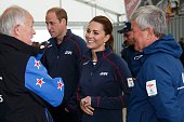 Prince William Duke of Cambridge and Catherine Duchess of Cambridge speak with dignitaries as they tour the base of Emirates Team New Zealand at the...