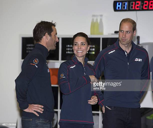 Prince William Duke of Cambridge and Catherine Duchess of Cambridge share a joke with Sir Ben Ainslie during a visit to the headquarters of Britain's...