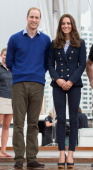 Prince William Duke of Cambridge and Catherine Duchess of Cambridge pose ahead of going sailing during their visit to Auckland Harbour on April 11...